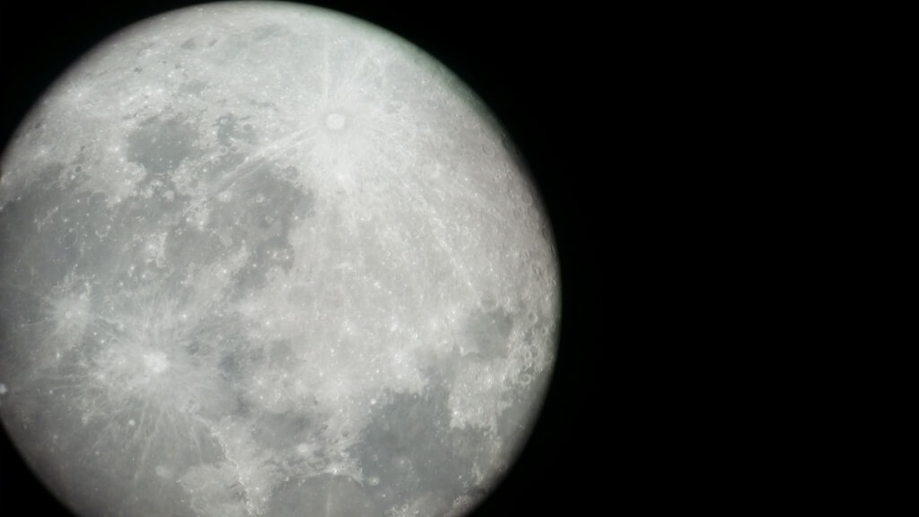 La luna through a telescope at Cruz del Sur Observatory.