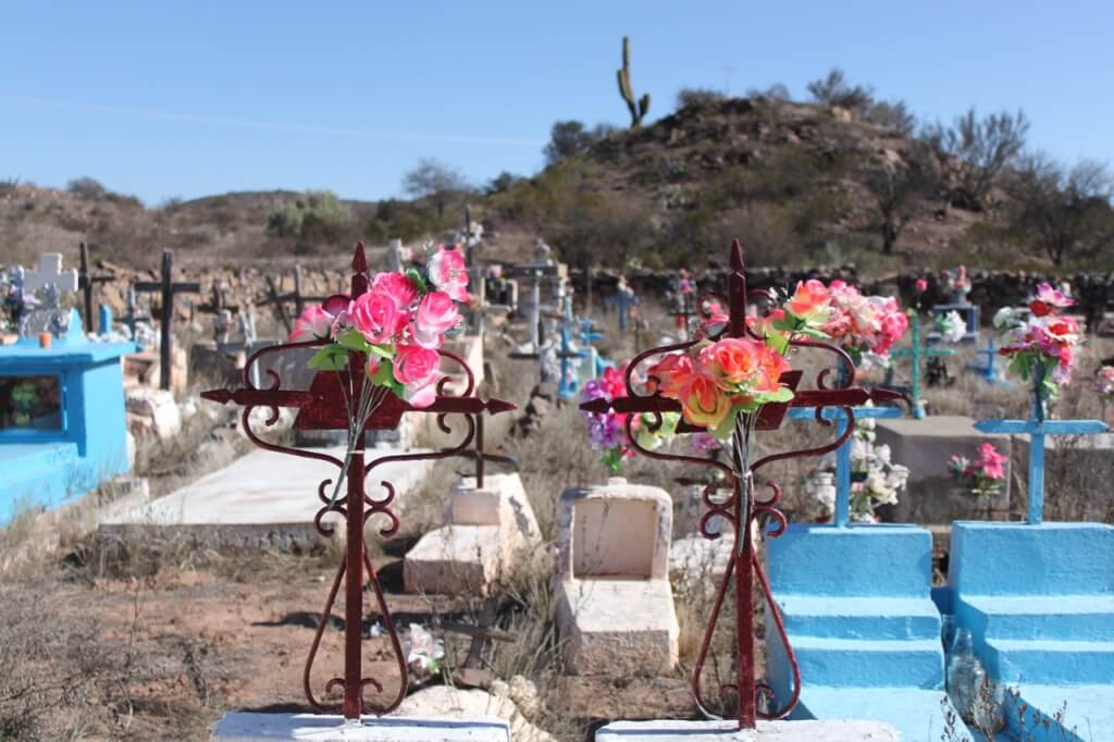 Cemeteries fascinate me, and those here are worth a visit. Many have mausoleums and tombs at ground level. They are all decorated with fake colorful flowers. Photo: V
