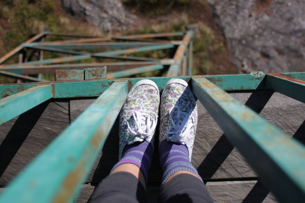 Amelia's feet atop a fire lookout in Benito Juarez National Park. Photo - Amelia
