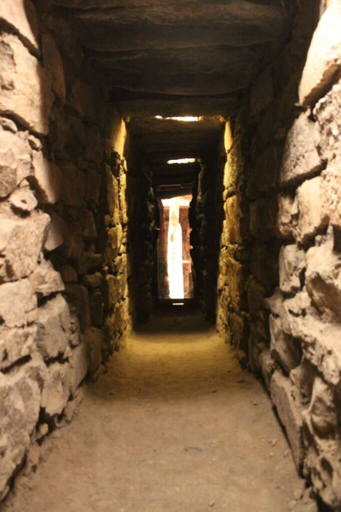 A tunnel leading to the Lance - a sacred stone - in the distance at Chavin de Huantar. Photo by Nate
